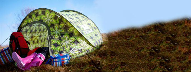 lifestyle camping image of tent on hill